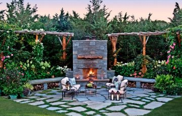 jardin-amplio-chimenea-muebles-acero-negro